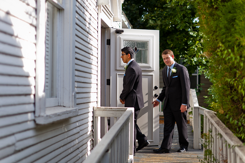 groomsmen walking into Johnson House