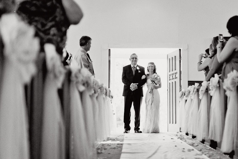 bride walking down isle at the Johsnson House