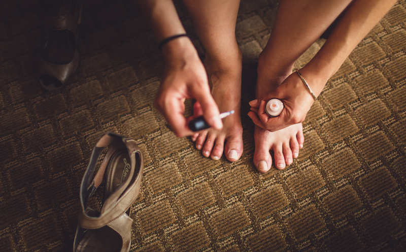 Bride painting her toe nails before wedding