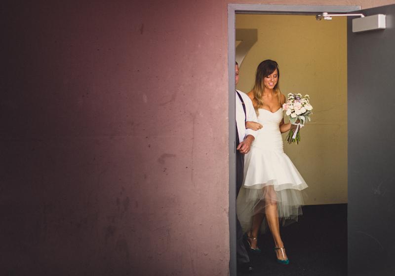 Bride walking down isle at Austin parking garage wedding