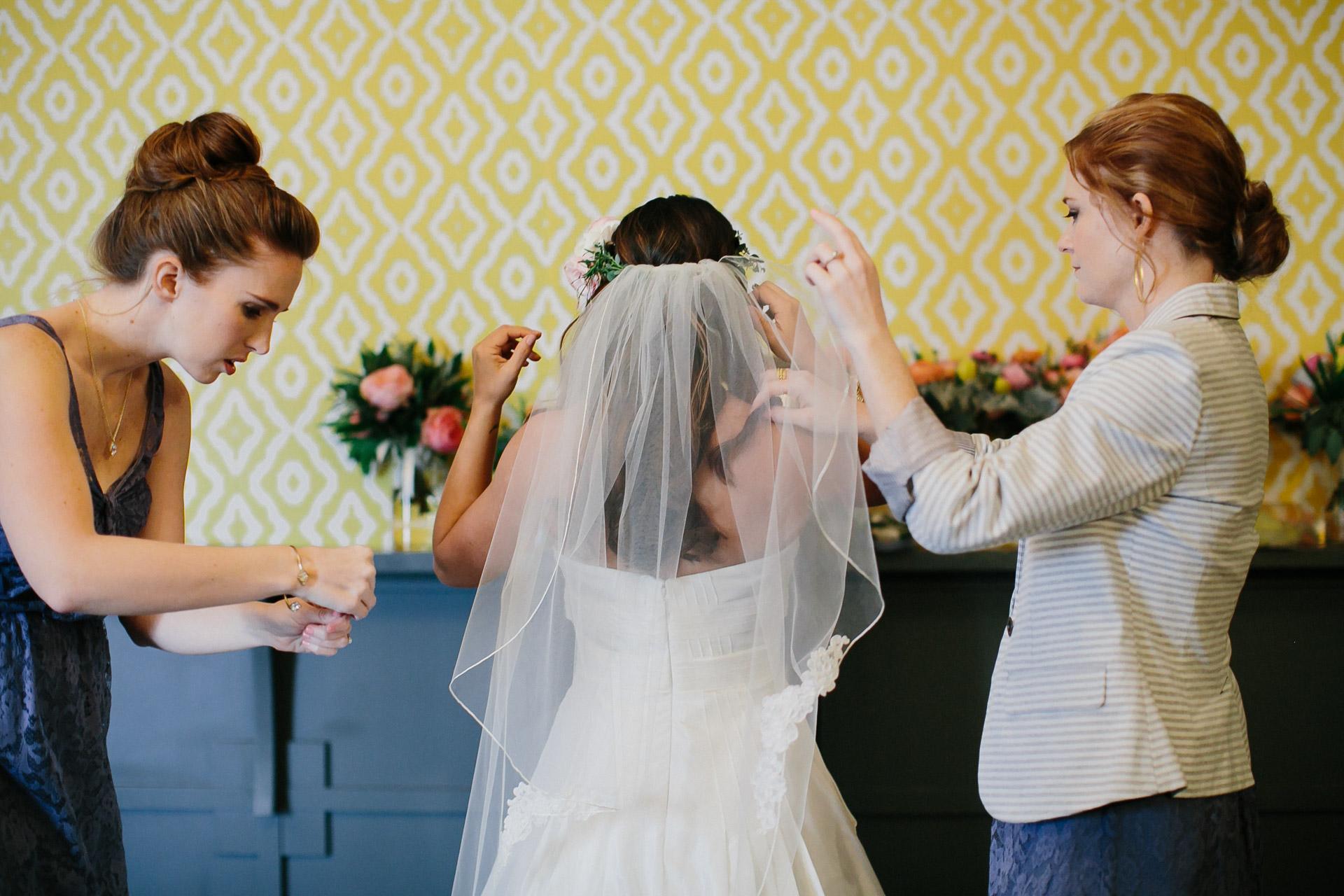 bride gettings dressed before belmont wedding
