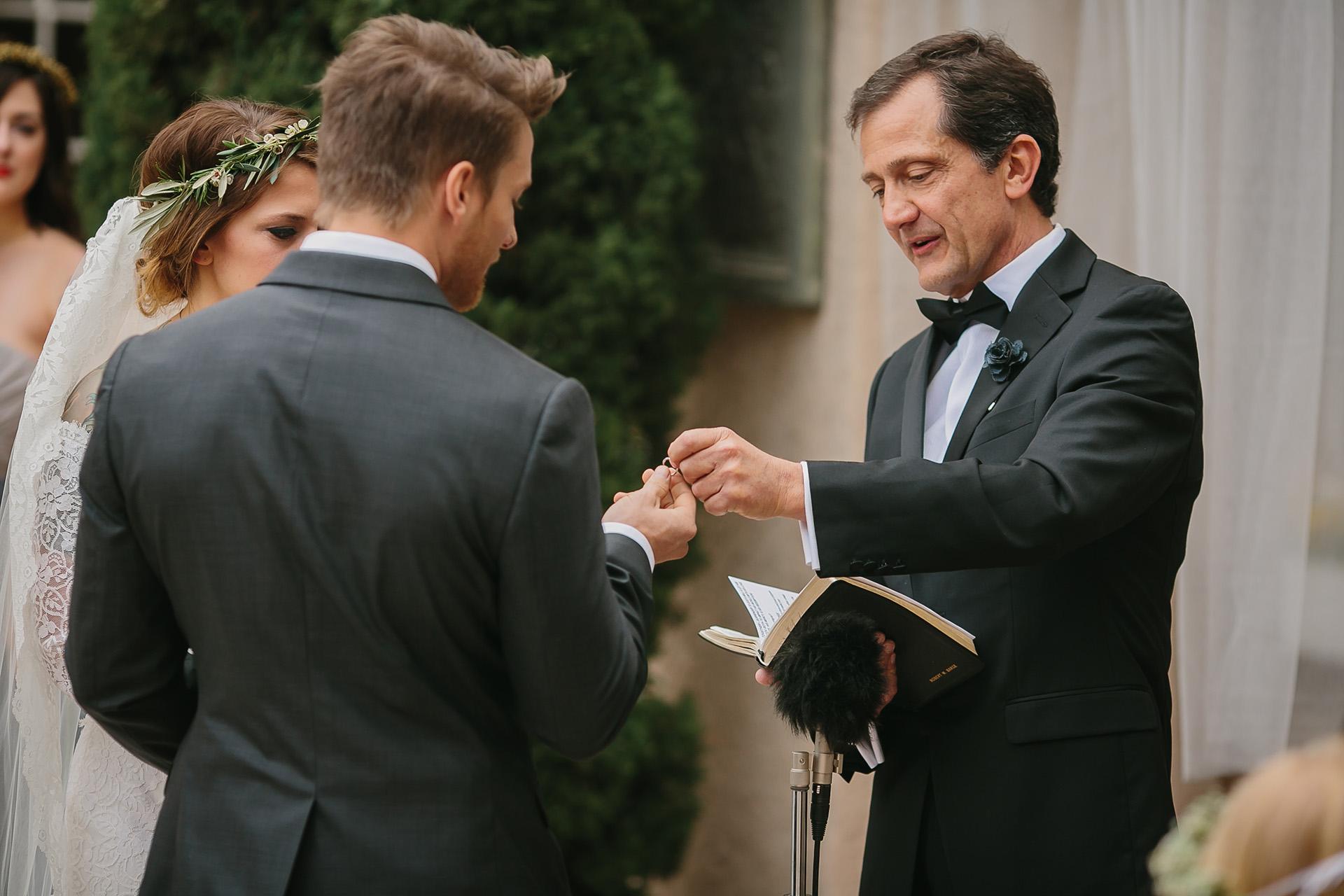 pastor handing rings