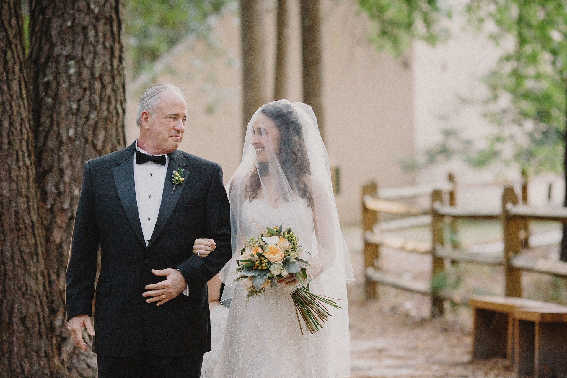 father walks bride down the isle