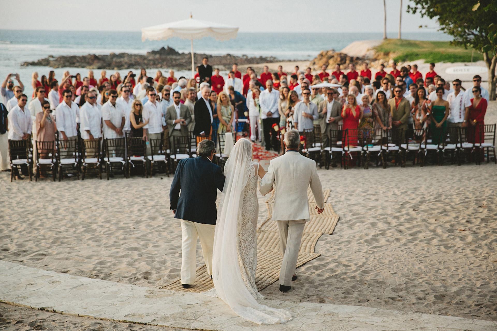 bride walking down isle at beach wedding