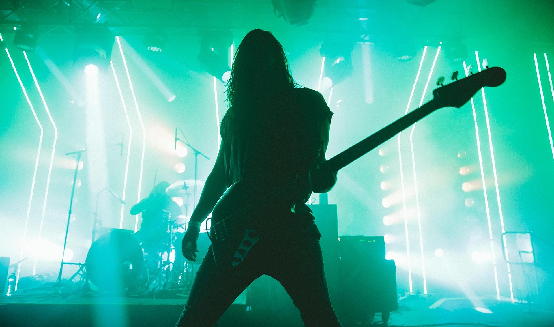 health, green concert lights, bass player