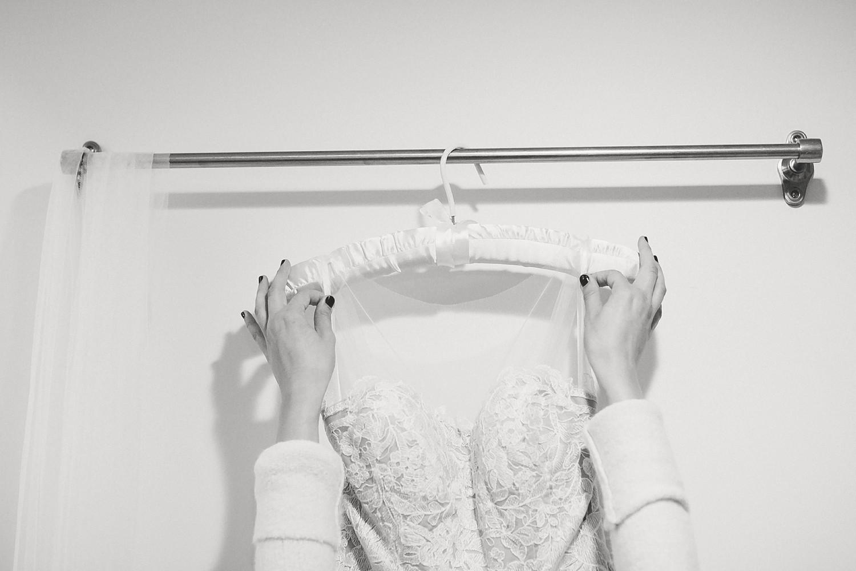 bride hanging dress